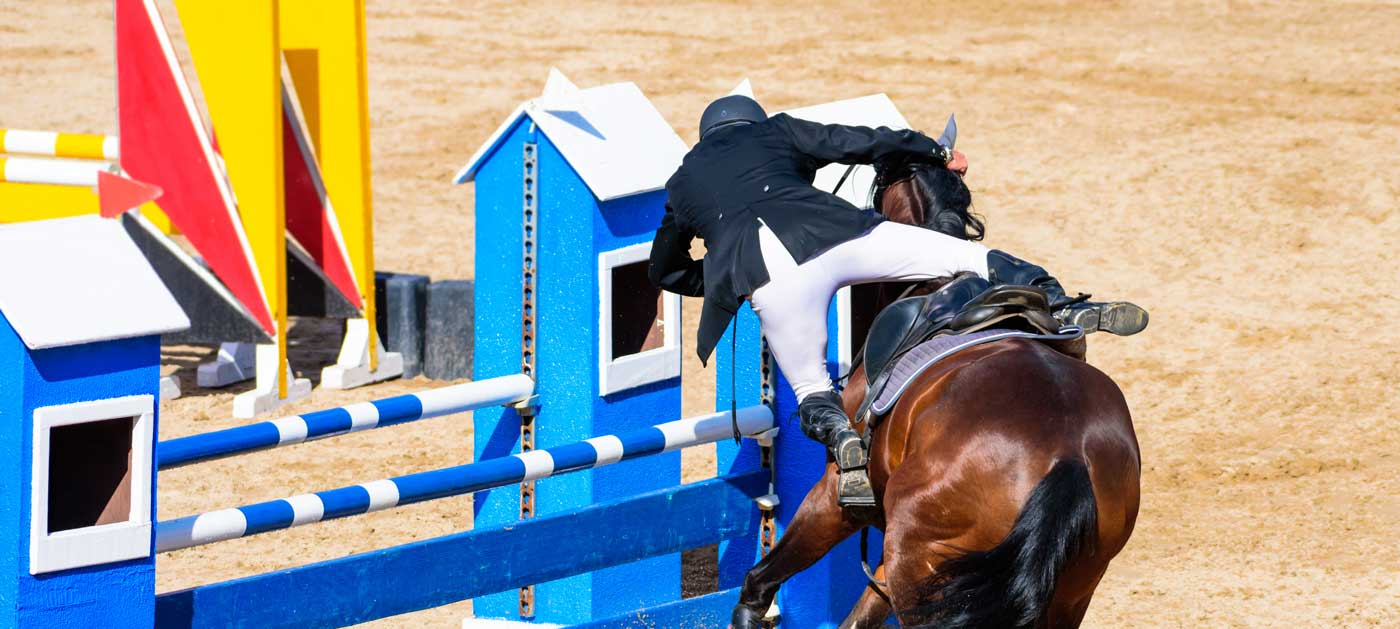 rider falling off horse at event